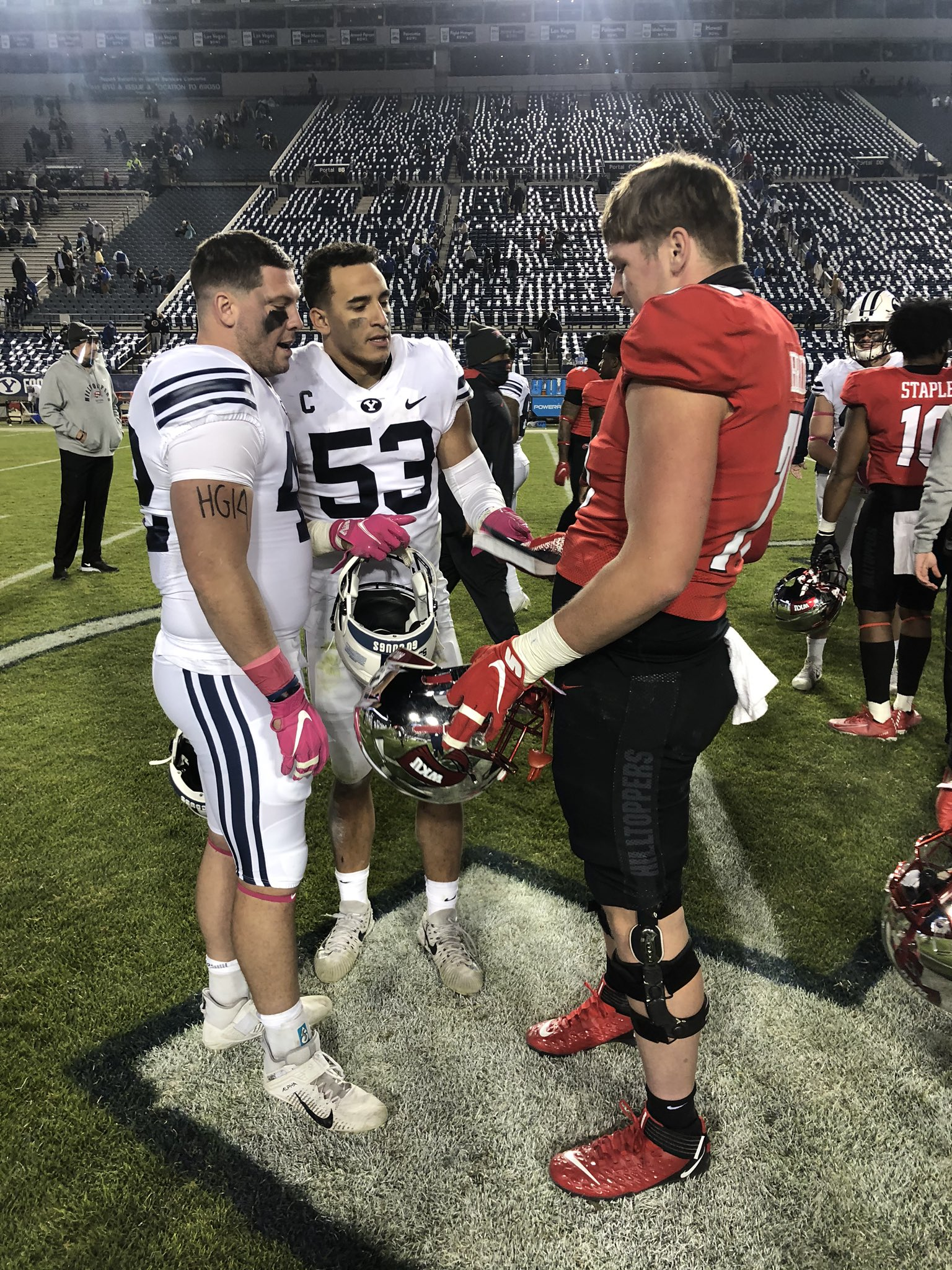 Every Linebacker a Missionary – Iconic Photo of Book of Mormon Exchange After BYU Football Game